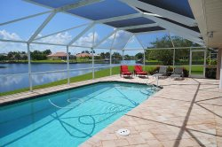 Blue Oasis - SW Cape Coral 3b/2ba Elect Heated Pool, Gulf Access Canal, HSW Internet, Boat Dock, 2 kayaks with small lift, 2 bicycles