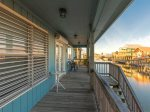 Enjoy bay views from the back of the wrap around deck