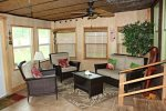 Sun room/ game room has games, dart board and folding game table