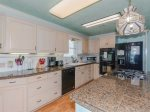 Fully equipped kitchen with an island for extra counter space