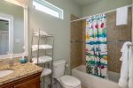 The second bedroom shares a bathroom with the third bedroom and has a tub/shower combo
