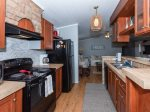The kitchen is fully equipped with a microwave, coffee maker, and dishwasher