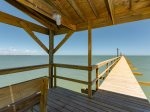 1000 foot lighted fishing pier with covered fishing area half way down the pier