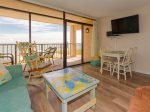 The living room has views of Aransas Bay and a flat screen TV