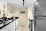 Fully equipped kitchen with dishwasher, microwave, and coffee maker