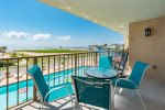The second floor patio overlooks the Laguna Reef pool and Aransas Bay