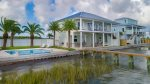 Luxury waterfront home with swimming pool and great fishing