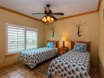Two twin beds and coastal decor in the second bedroom