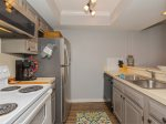 Fully equipped kitchen with microwave, coffee maker, and toaster