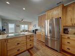 Large kitchen equipped with modern appliances