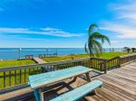Enjoy sunrises, fishing, dolphin viewing, and bird watching from the back yard