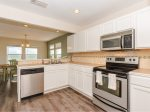 Fully equipped kitchen with all new appliances and tiled counter tops