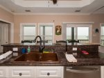 Open floor plan lined with windows overlooking Copano Bay