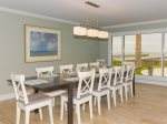The dining room table seats up to 12 people and has breathtaking views of Copano Bay