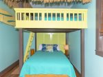 The tiki suite has a queen/double bunk bed and en suite half bath