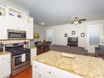 The fully equipped kitchen has stainless steel appliances and granite countertops