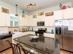Kitchen is fully equipped and has granite counter tops