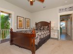 The master bedroom has a queen sized bed and private balcony over looking the pool