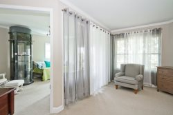 Privacy curtains between sitting area and daybed room