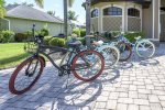 Electrically heated swimming pool with picture window screening