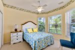This guest bedroom is located at the right front of the house, it features a queen size bed, dresser and 2 nightstands. It shares a jack and jill bathroom with bedroom 3