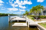 Sailboat access canal with a large dock and boat lift