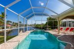 The pool deck features lots of lounging space and a large swimming pool