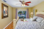 Sunset Point Master bedroom featuring a queen size bed with access to pool area