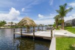 Beautiful waterfront setting with large dock and tiki hut