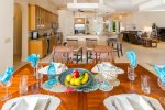 Villa Monica Dining featuring an open floor plan with view to the kitchen and living room