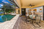 Villa Monica covered lanai featuring table with seating up to 6 guests and cozy lounge area