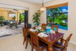 Villa Monica Dining with pool and canal view and seating for 6 guests