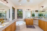Villa Monica Master Bathroom with his and her sink and make up area, garden tub and walk in shower