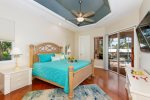 The master bedroom features a king size bed and access to the lanai