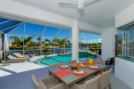 Spacious under truss lanai sitting area with breathtaking view of the pool and water basin canal