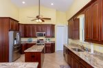 Spacious kitchen with solid wood cabinets and granite tops