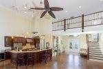 Open living at its finest, view from living room to upstairs cat walk and open gourmet kitchen