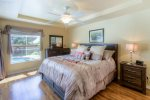 The master bedroom features hard wood flooring