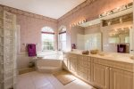 Dual sinks, soaking tub and walk in shower as well as a separate toilet in the master bathroom