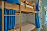 2 twin bunk beds in hallway