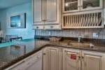 Granite countertops and nice cabinets in kitchen