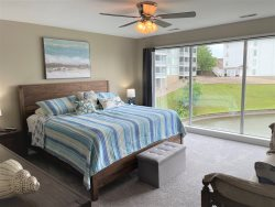 2nd bedroom is a mini-suite.  Queen size bed with access to the 2nd bathroom.  French doors open to the entry seating area