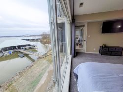 View of the condo front door with a private patio, bistro seating and gas grill.  Oberlooks the lakefront