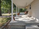 Covered front porch with a great swing.  Perfect for lake viewing and bird watching, reading and relaxing.