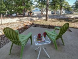 Just off the front porch is a cement patio, perfect for morning coffee outside wit a lake view.
