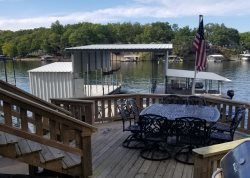 Large lakefront deck just off the living room.  Perfect for entertaining with patio seating and gas grill.