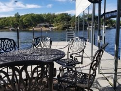 Lots of patio seating on dock as well - 2 tables and lots of chairs.