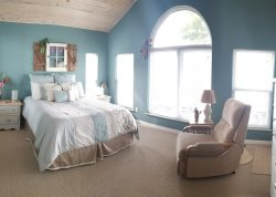 Extremely spacious Master Suite - queen bed - vaulted ceiling and windows overlook the lake