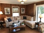 Comfortable Living Room Sectional with Full Sofa Sleeper and Slider Door Access to the Deck
