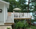View of Outside Deck with Patio Seating for 6.  Includes a Large Gas Grill.